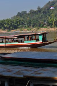 Long Laotian Boats on Mekong River