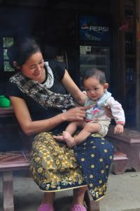 The Women in Traditional Clothes with A Baby